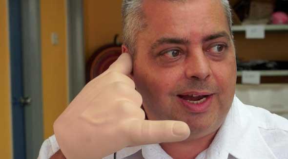 Handiheadset - Auricular para móviles con forma de mano